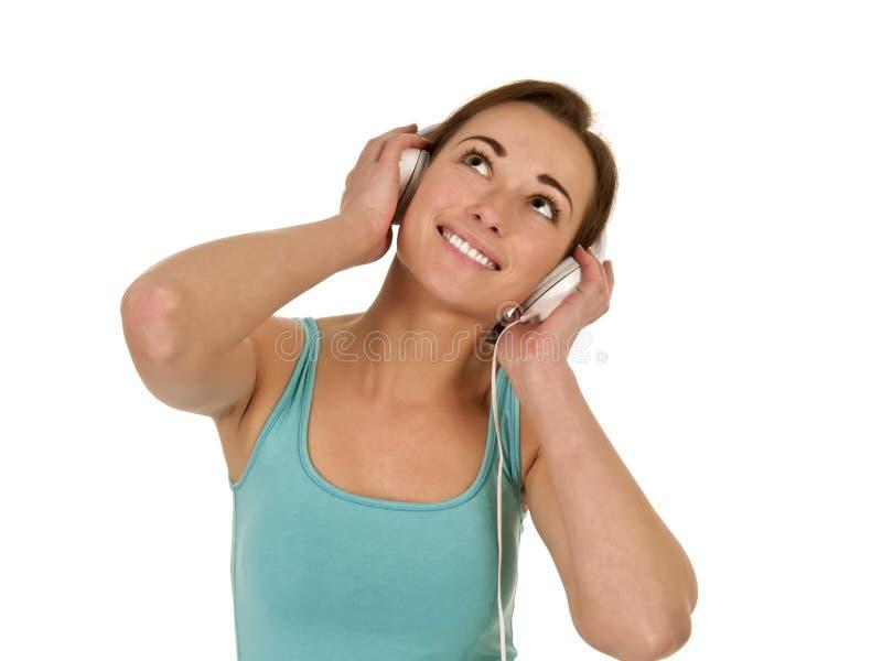 Hübsche Frau mit Kopfhörern stockfotos