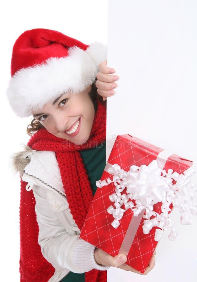 Hübsche Frau am Weihnachten stockfoto