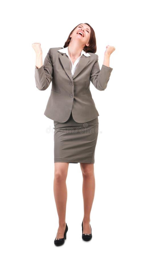 Hübsche Geschäftsfrau in der grauen Klage lokalisiert auf weißem Hintergrund stockbild