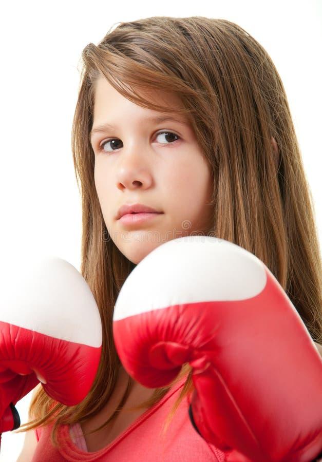Hübsche Jugendliche mit roten Verpackenhandschuhen stockfotografie