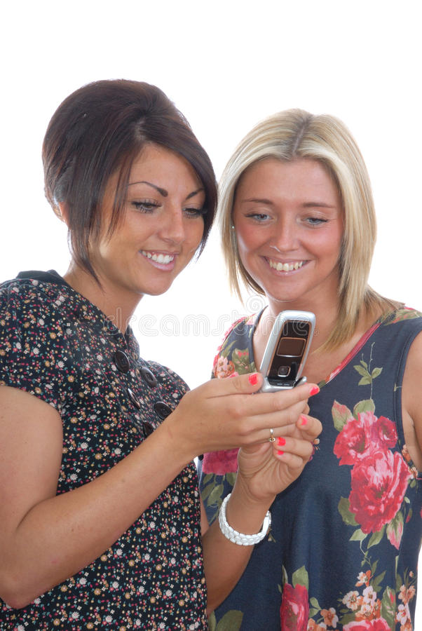 Hübsche Mädchen und Mobiltelefon lizenzfreies stockbild