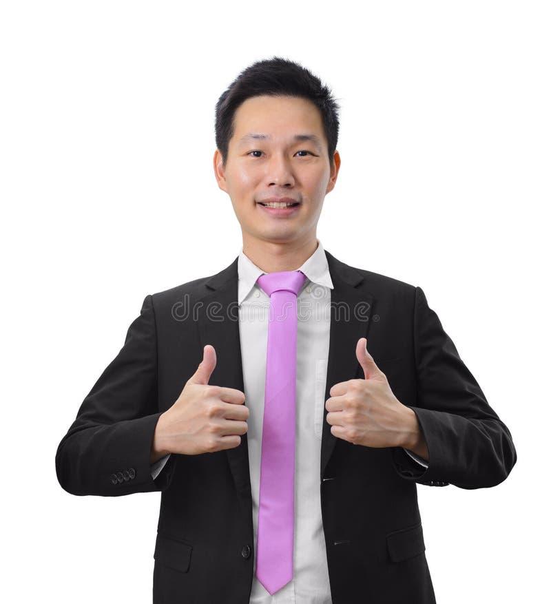 Hübscher asiatischer Geschäftsmann des Porträts, der doppelten Daumen aufgibt stockfotos