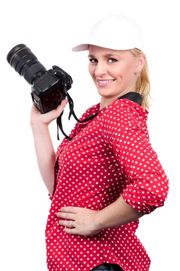Hübscher Blondinephotograph mit Kamera, auf Weiß stockfoto
