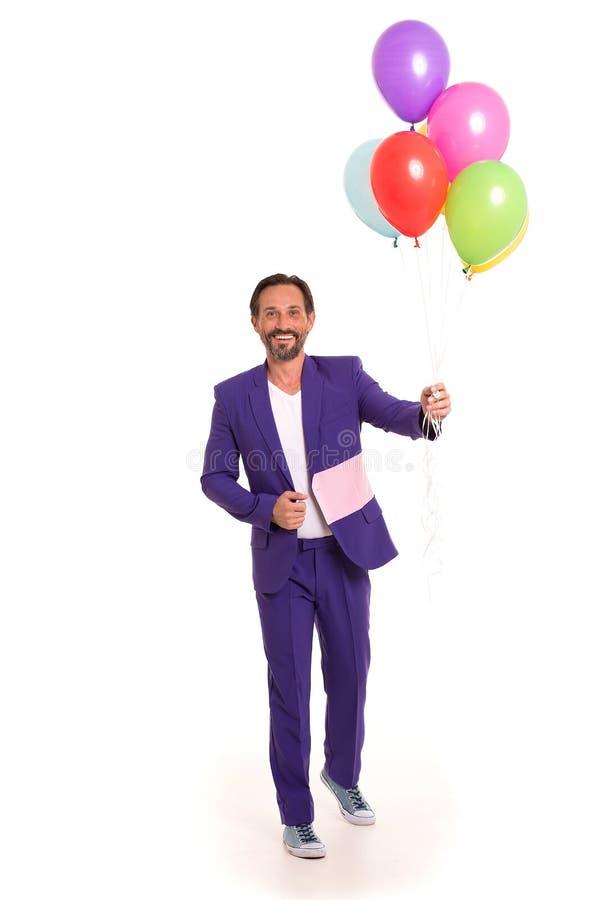 Hübscher Clown mit Ballonen lizenzfreies stockbild