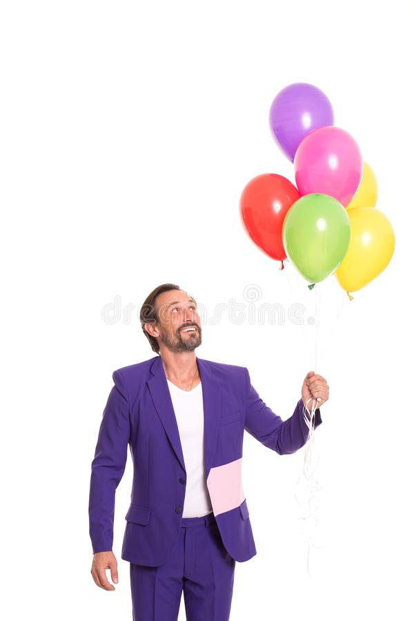 Hübscher Clown mit Ballonen stockbild