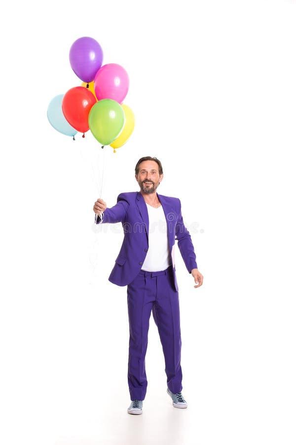Hübscher Clown mit Ballonen stockfotografie