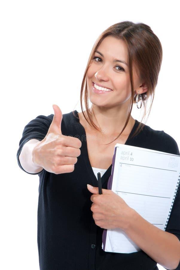 Hübscher Geschäftsfraudaumen oben lizenzfreie stockbilder