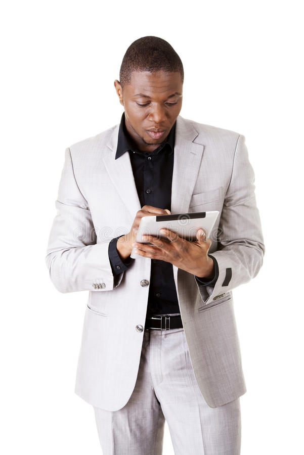 Hübscher Geschäftsmann mit Tablette stockbilder
