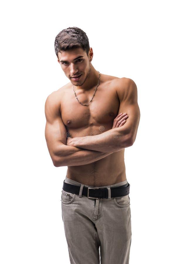 Hübscher hemdloser athletischer junger Mann auf Weiß lizenzfreie stockfotos