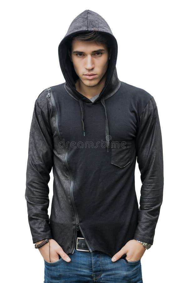 Hübscher junger Mann in der schwarzen Hoodiestrickjacke lokalisiert auf Weiß stockfotos