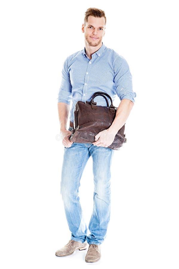 Hübscher junger Student mit Laptoptasche lizenzfreie stockbilder