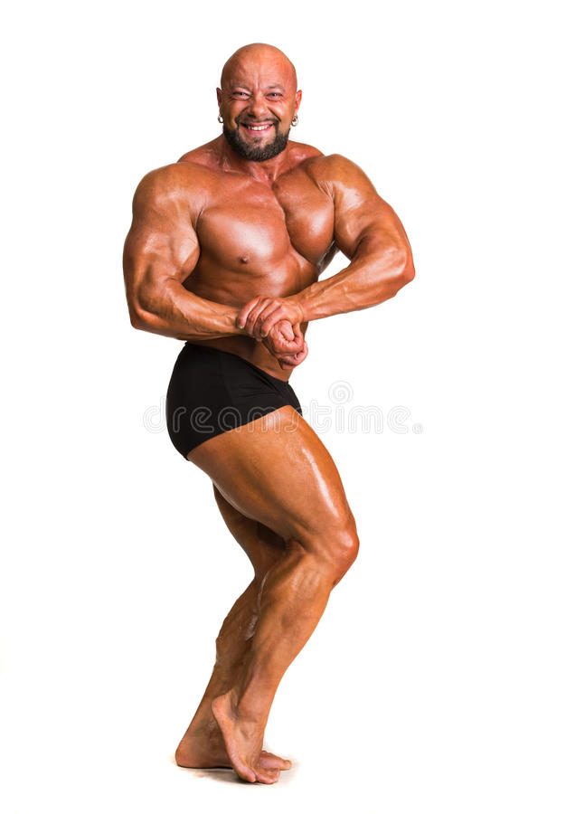 Hübscher muskulöser Bodybuilder lizenzfreies stockbild
