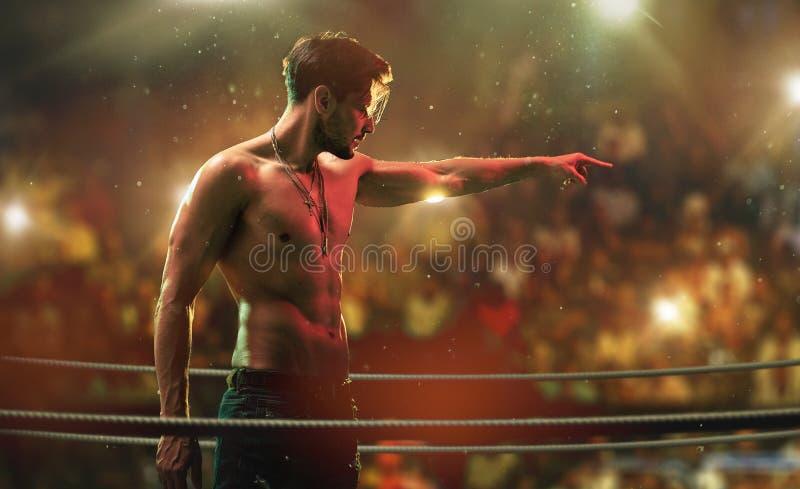 Hübscher, muskulöser Mann auf dem Kampfvereinring lizenzfreie stockfotografie