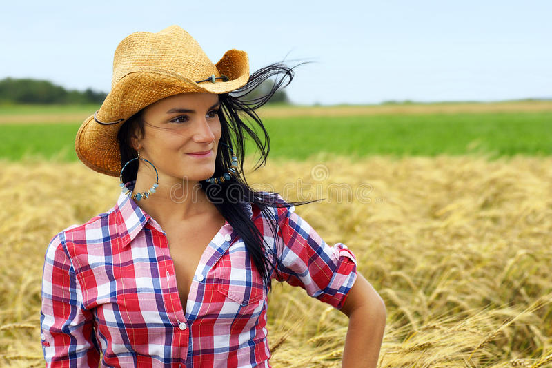 Hübsches Cowgirllächeln stockfotos