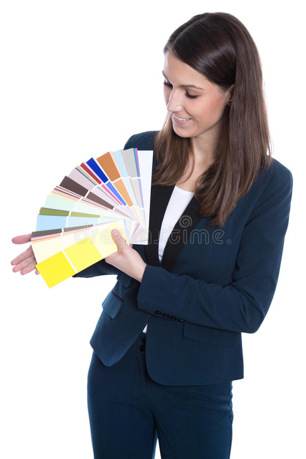 Hübsches Geschäftsmädchen, welches die Farbpalette lokalisiert auf Weiß darstellt. lizenzfreie stockbilder