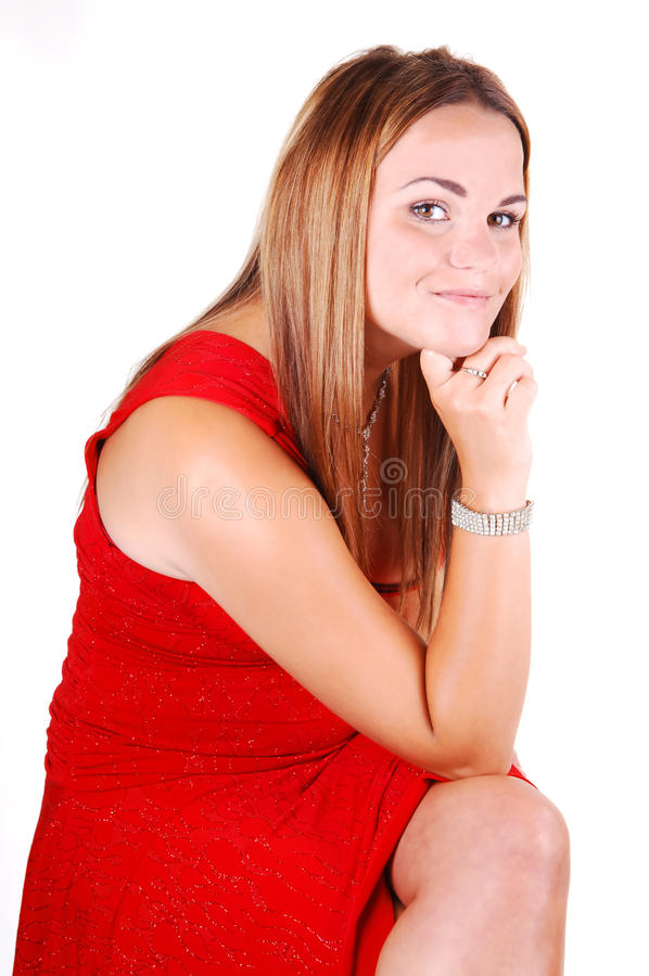 Hübsches Mädchen im roten Kleid. stockfotografie