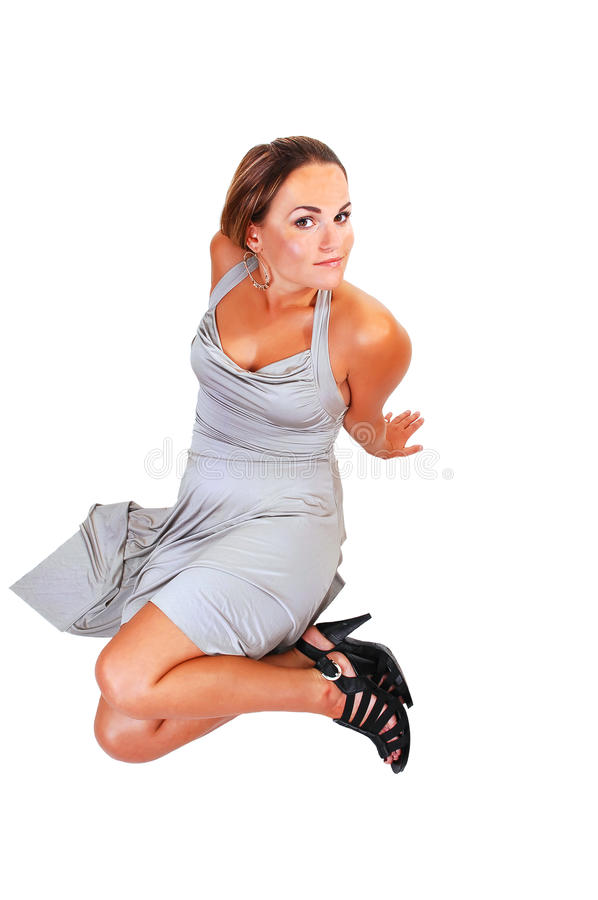 Hübsches Mädchen im silbernen Kleid. stockbilder