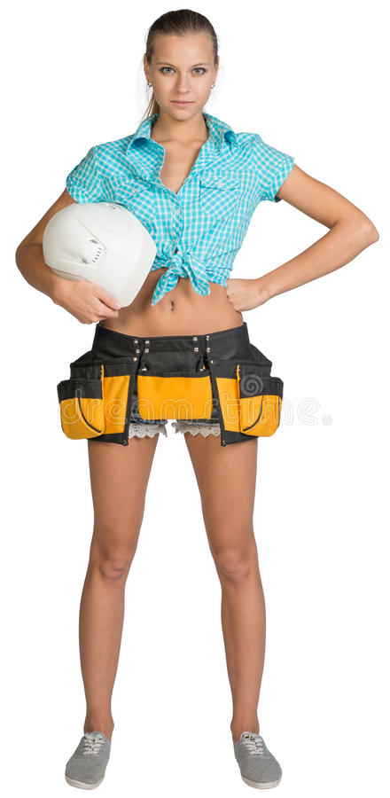 Hübsches Mädchen kurz gesagt, Hemd und Werkzeug schnallen das Halten um stockfotografie