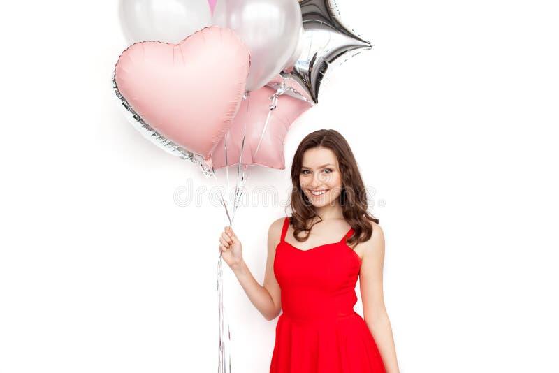 Hübsches Mädchen mit Ballonbündel stockfotos