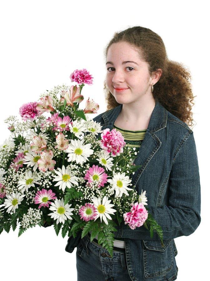 Hübsches Mädchen mit Blumen stockbilder