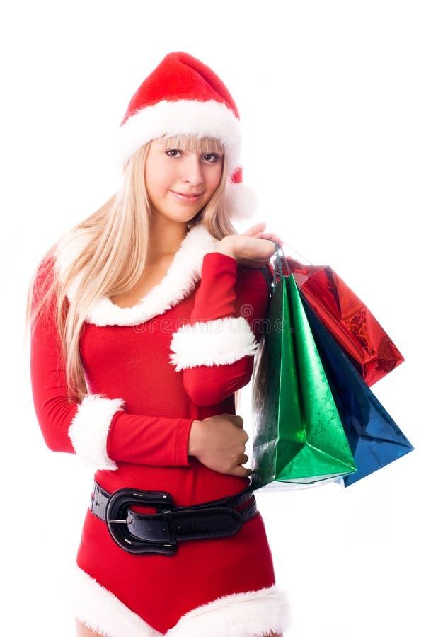 Hübsches Mädchen mit Einkaufenbeuteln lizenzfreies stockfoto