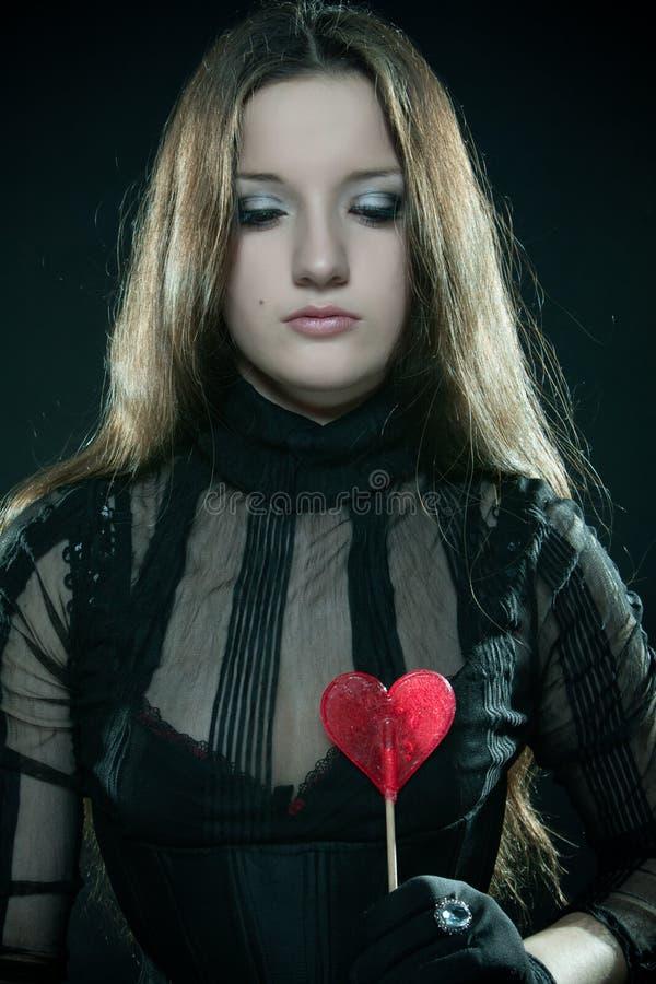 Hübsches Mädchen mit Lutscher stockfotos