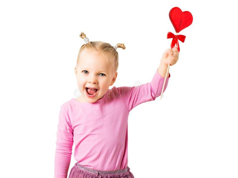 Hübsches Mädchen mit roter heller Lutschersüßigkeit lizenzfreies stockbild