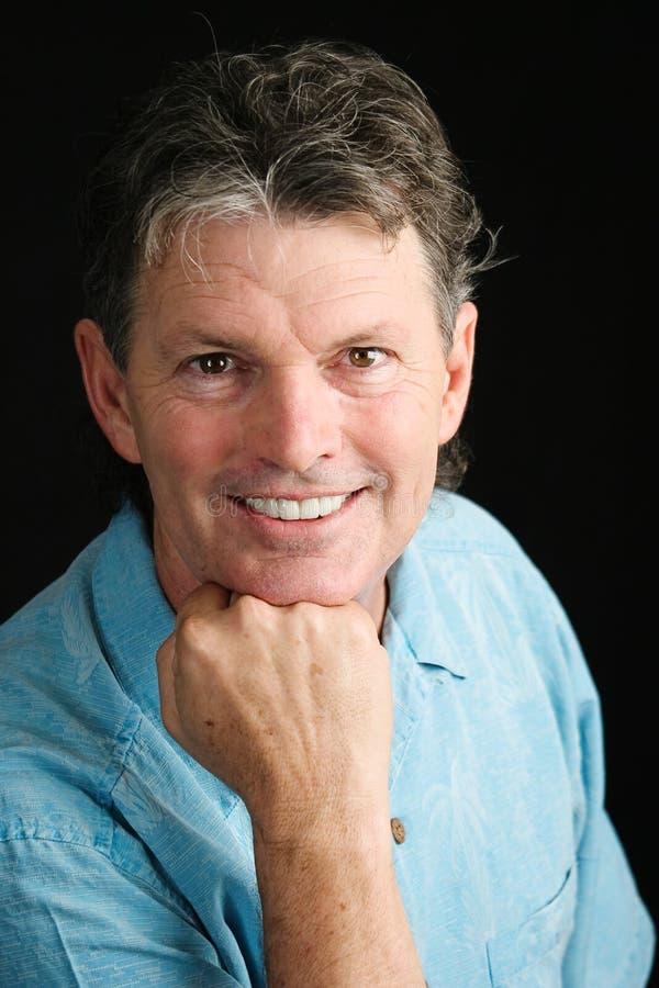 Hübsches Mann-Lächeln von mittlerem Alter stockbild