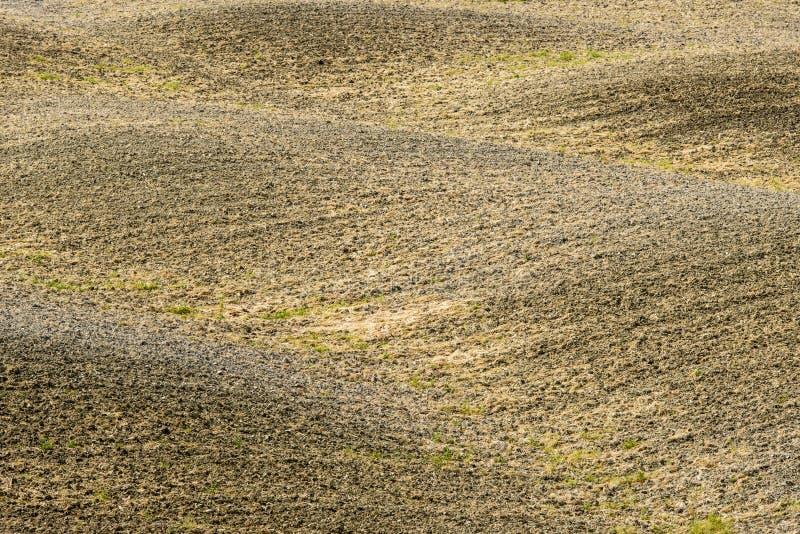Hügelig leeren Sie Felder stockfoto