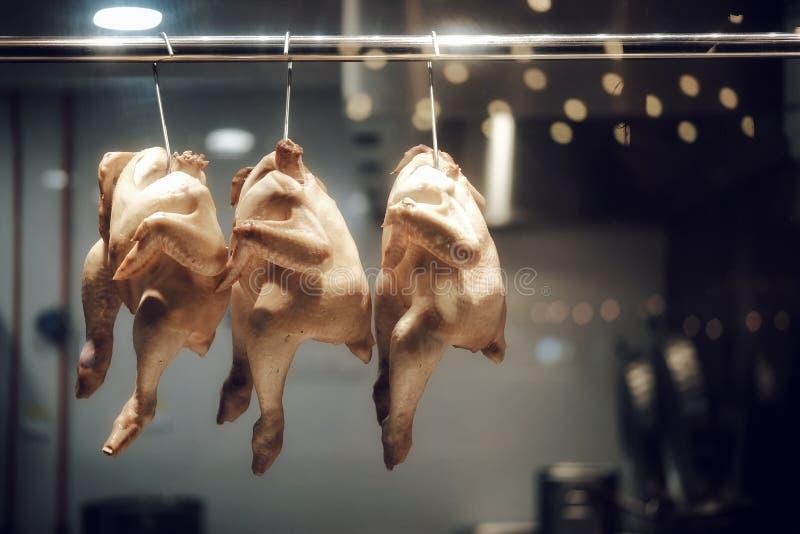 Hühnerlebensmittel hängendes chickenrice stockbild