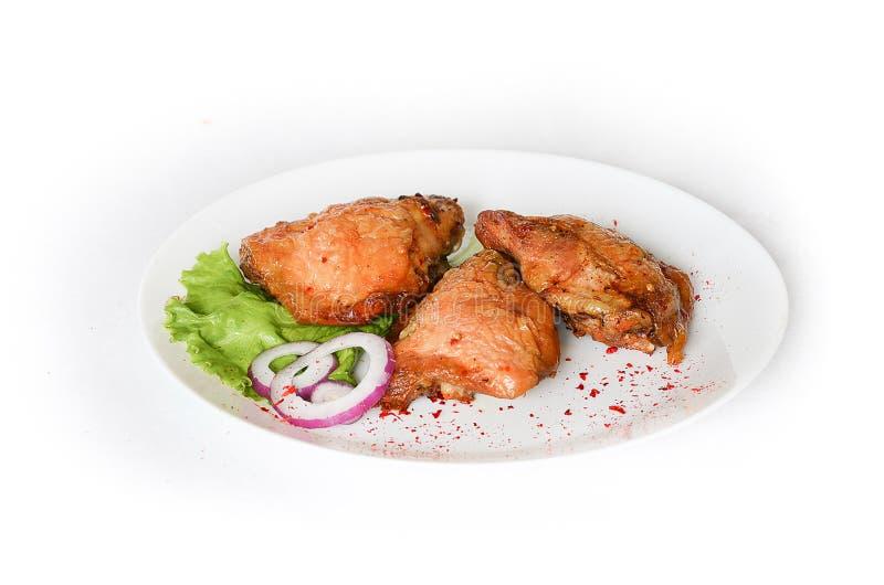 Hühnerschenkel gebacken im Ofen lizenzfreies stockfoto