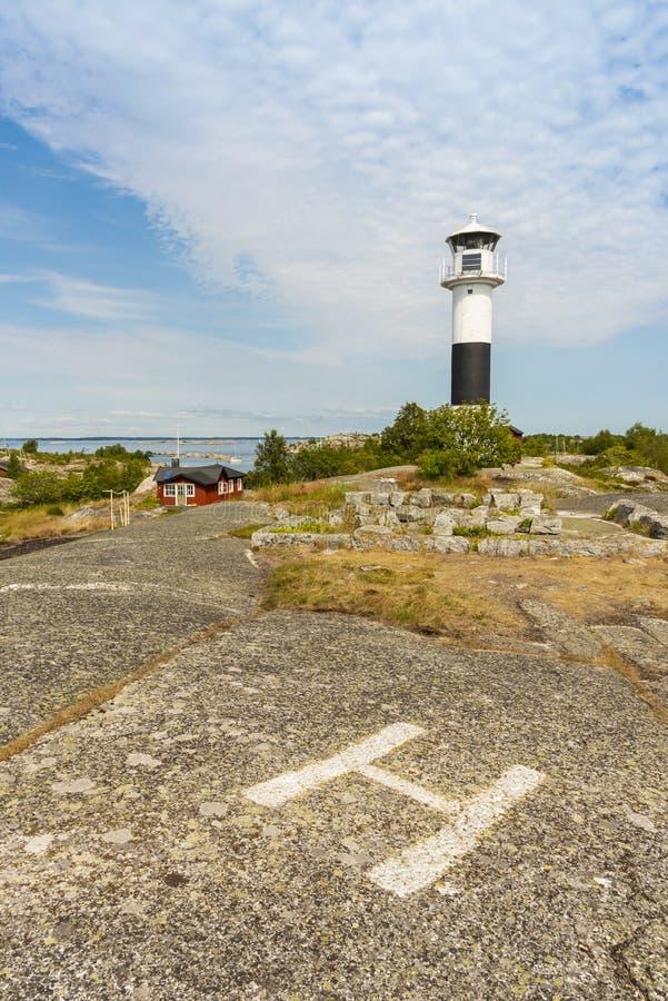 H för bokstav för Huvudskär fyrStockholm achipelago arkivbild