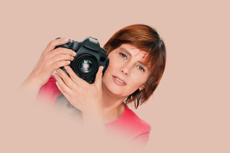 H?g kvinnafotograf royaltyfria foton