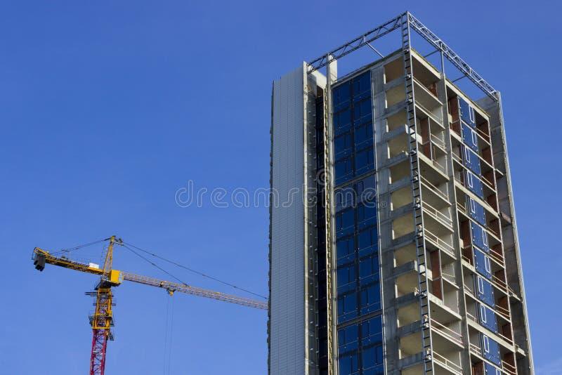 h?g stigning f?r byggnadskonstruktion under royaltyfri fotografi