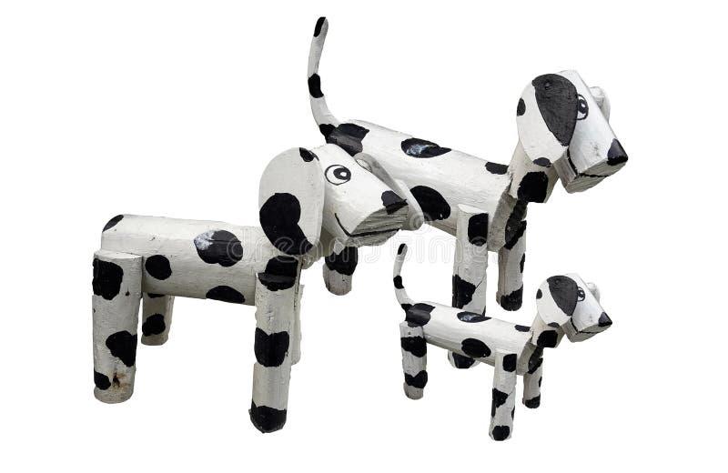 H?lzerne Hundefamilienstellung lokalisiert auf wei?em backgtound lizenzfreies stockfoto