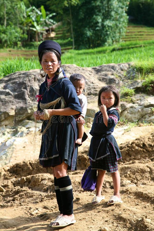 H'Mong People of Sapa Vietnam. SAPA, VIETNAM: unidentified H'mong hilltribe children older woman in Sapa, Vietnam stock photography