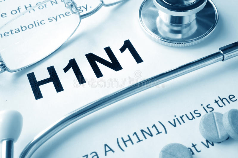 H1N1 disease. Paper with word H1N1 disease and stethoscope stock photo
