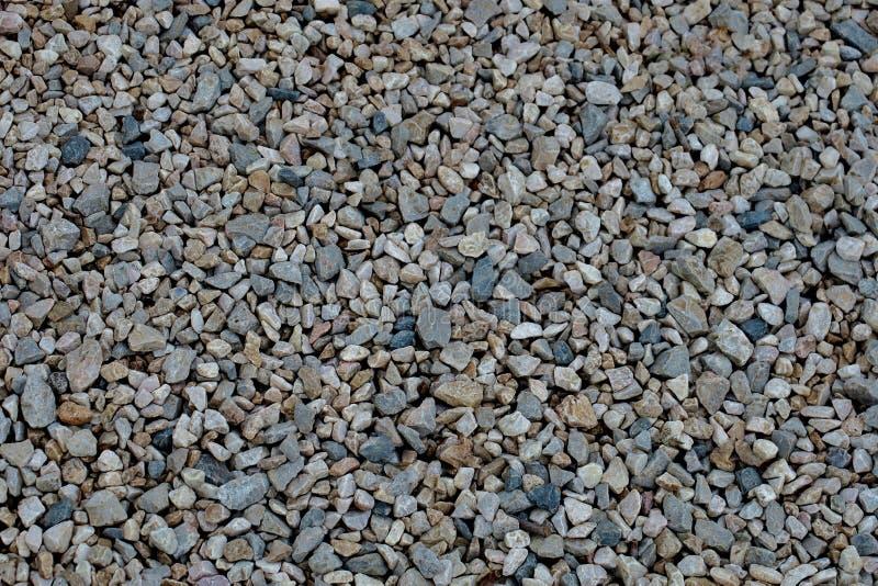 H?rlig ovanlig bakgrund av sm? stenar arkivbilder
