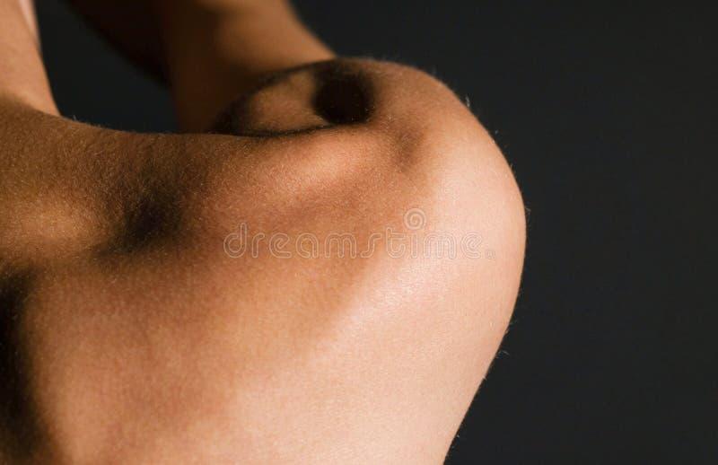 H?rliga kvinnas skuldra arkivbild