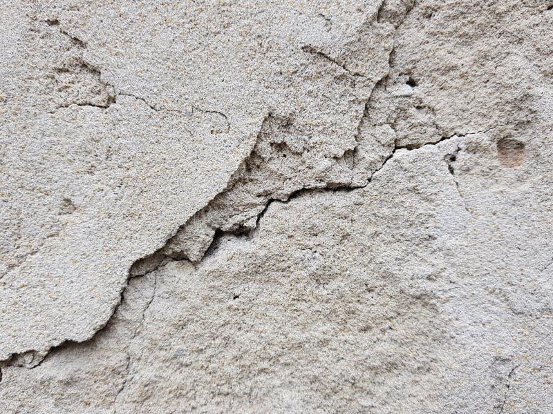 H?rligt lutningbakgrundsbaner f?r ovanlig och h?rlig textur f?r text - av murbruk eller betongv?ggen med sprickor fotografering för bildbyråer