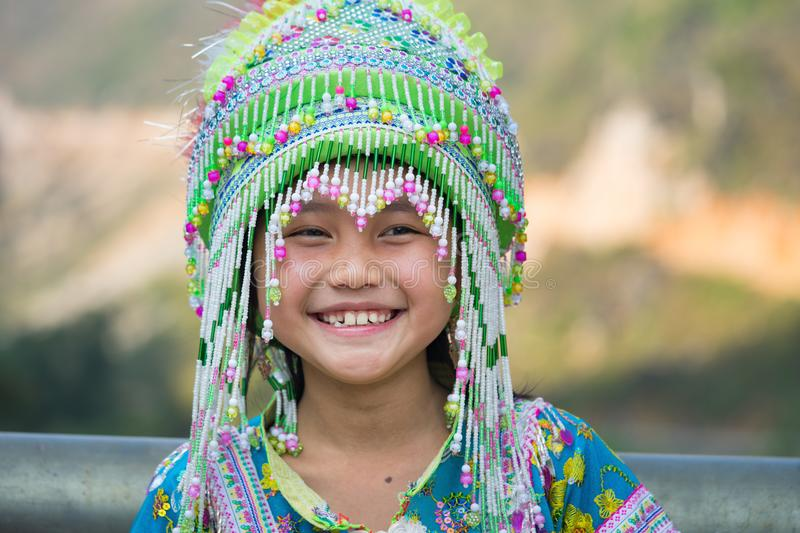 Ha Giang, Vietnam - Feb 13, 2016: Portrait of H`mong little girl wearing traditional dress during Lunar New Year holiday in stock photo