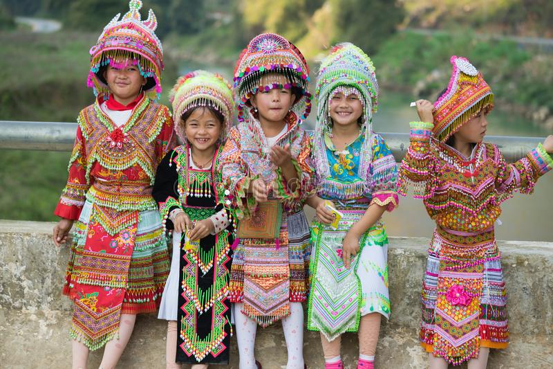 Ha Giang, Vietnam - Feb 13, 2016: Portrait of H`mong little girls wearing traditional dress during Lunar New Year holiday in royalty free stock photo