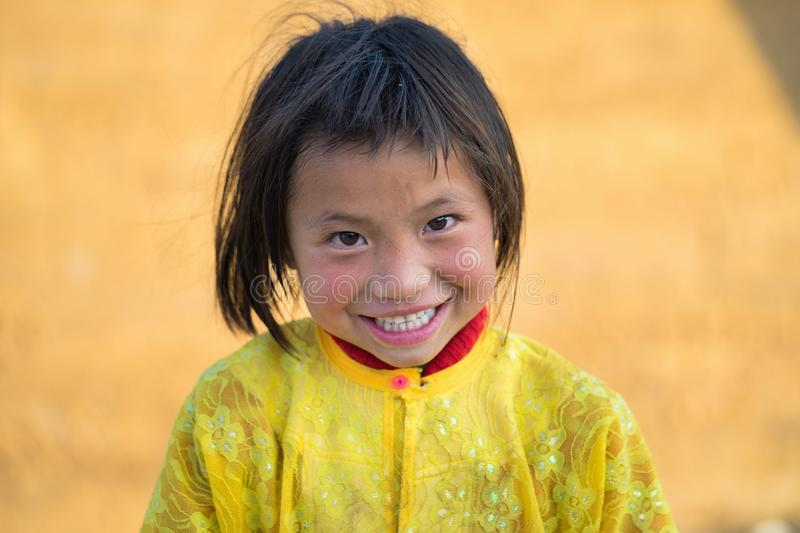 Ha Giang, Vietnam - Feb 14, 2016: Portrait of smiling H`mong little child in Van district.  royalty free stock photography