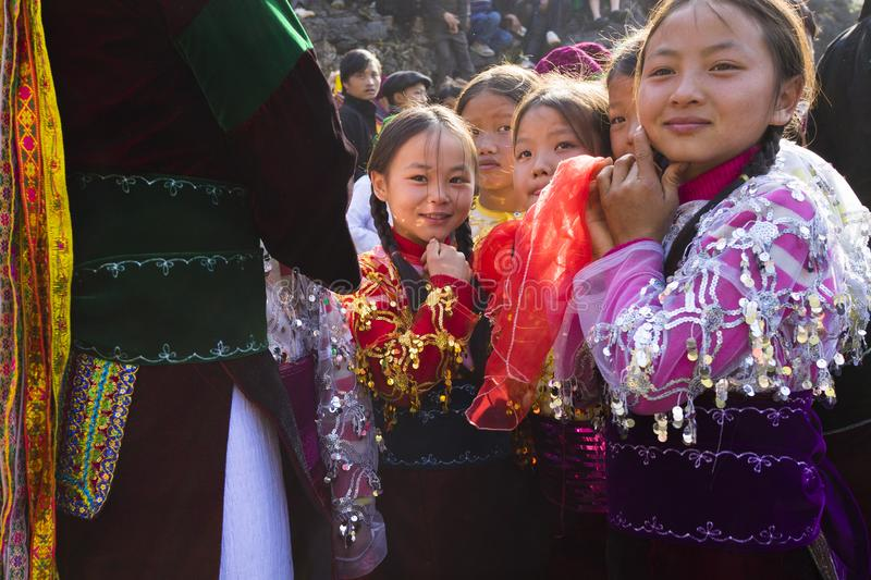 Ha Giang, Vietnam - Feb 7, 2014: Unidentified group of children wearing Hmong traditional new year clothe, waiting for their danci. Ng perform in a mountainous stock photos