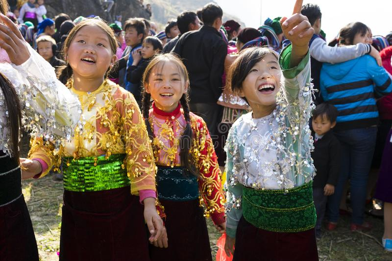 Ha Giang, Vietnam - Feb 7, 2014: Unidentified group of children wearing Hmong traditional new year clothe, waiting for their danci. Ng perform in a mountainous stock image