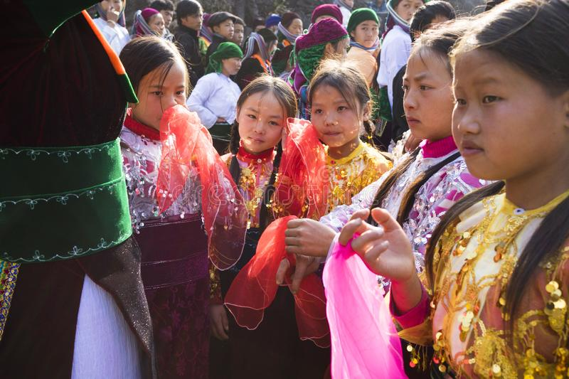 Ha Giang, Vietnam - Feb 7, 2014: Unidentified group of children wearing Hmong traditional new year clothe, waiting for their danci. Ng perform in a mountainous stock photography