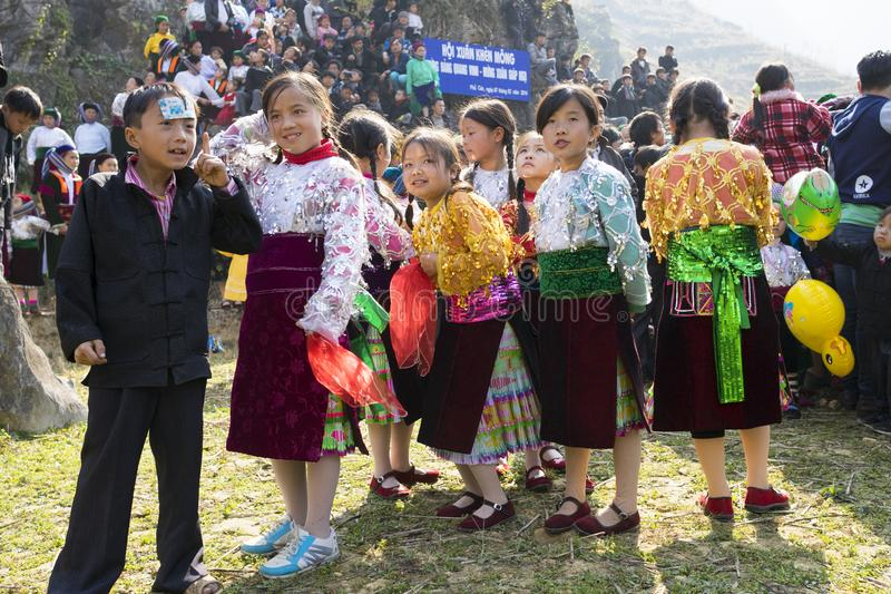 Ha Giang, Vietnam - Feb 7, 2014: Unidentified group of children wearing Hmong traditional new year clothe, waiting for their danci. Ng perform in a mountainous royalty free stock images