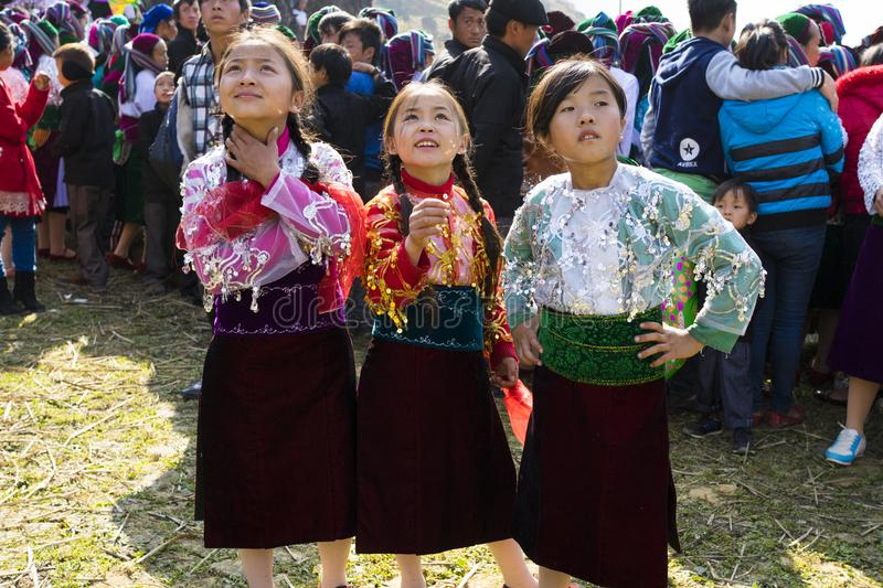 Ha Giang, Vietnam - Feb 7, 2014: Unidentified group of children wearing Hmong traditional new year clothe, waiting for their danci. Ng perform in a mountainous royalty free stock photos