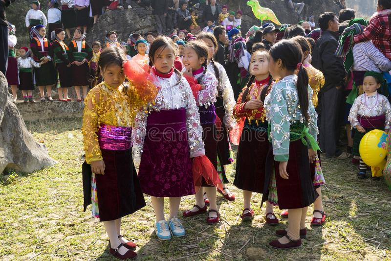 Ha Giang, Vietnam - Feb 7, 2014: Unidentified group of children wearing Hmong traditional new year clothe, waiting for their danci. Ng perform in a mountainous royalty free stock image