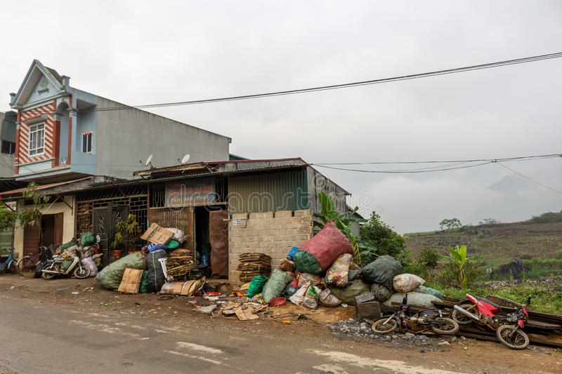 Northern Vietnam village dirt. Ha Giang, Vietnam - March 17, 2018: Houses on the main road of a remote village in northern Vietnam royalty free stock images